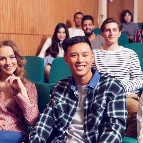 Students smiling in a lecture theatre