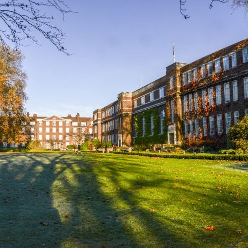Back of Tuke Hall and red brick campus
